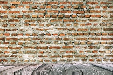 Empty Wooden Table with Old Brick Wall Texture Background, Suitable for Presentation, Web Temple, Backdrop, and Product Display. Stock Photo