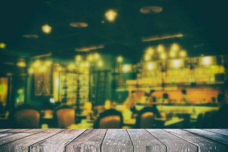 Empty Wooden Table with Blurred Restaurant Background in Food and Drink Concept, Suitable for Presentation, Web Temple, Backdrop, and Product Display. Stock Photo