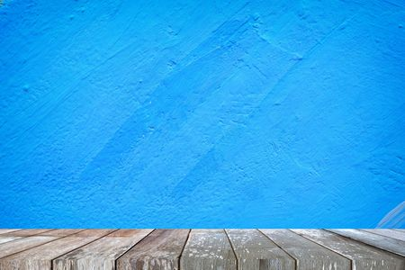 Empty Wooden Table with Blue Painted Concrete Wall Background, Suitable for Presentation, Web Temple, Backdrop, and Product Display. Stok Fotoğraf