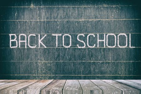 Empty Wooden Table with Back to School Chalk Writing on Old Chalkboard Background, Suitable for Presentation, Web Temple, Backdrop, and Product Display.