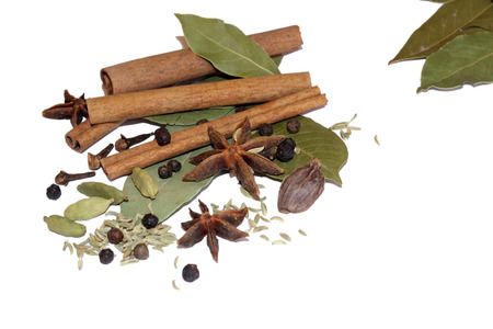 things that go together: Mixed spices and bay leaves Stock Photo