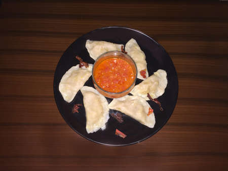 Tasty Manti in plate with sauce