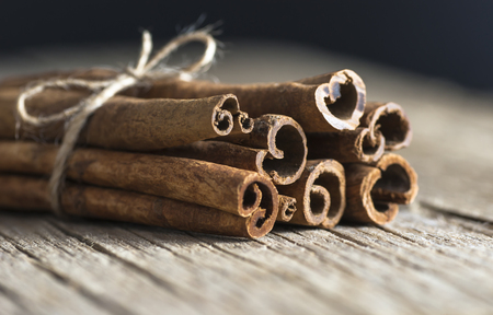 Close up cinnamon healthy spice on wooden background