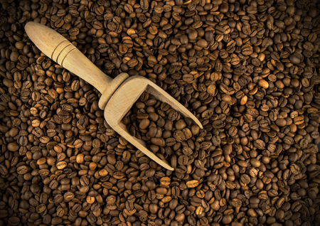Close up coffee beans with wooden shovel Stock Photo