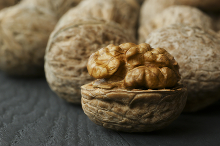 close up of wooden backdrop. healthy food for brain. walnut background Foto de archivo - 110428766