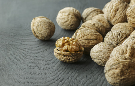 walnut healthy food for brain. walnut background Foto de archivo - 110428770