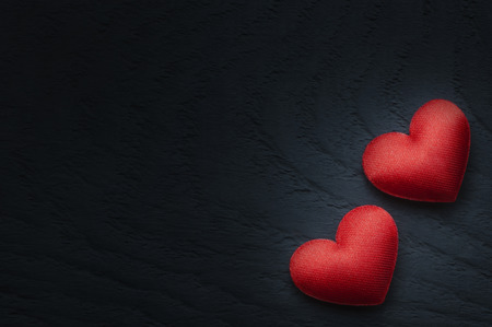 Red hearts on wooden table. St. Valentines Day background Stock Photo
