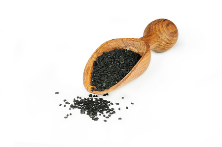 Black cumin seeds isolated on white background. Organic herbal medicine