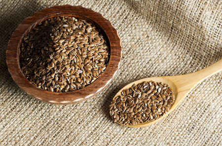 Heap of Flax or sack backdrop. Flaxseed or linseed concept. Flax seed dietary fiber background 스톡 콘텐츠