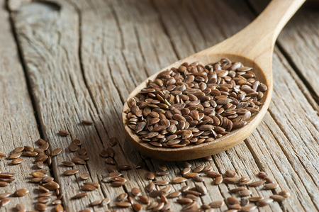 Heap of Flax Seeds Flaxseed or linseed concept. Flax seed dietary fiber background 스톡 콘텐츠 - 115886891