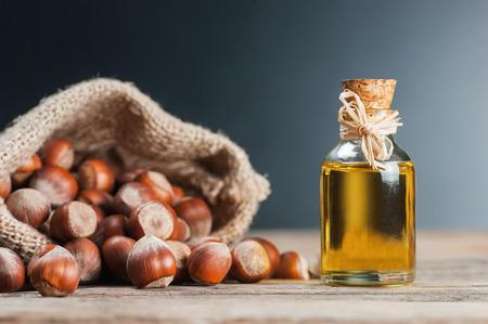 Hazelnuts, burlap sack and hazelnut oil. heap or stack of hazelnuts. Hazelnut background, healty food Stok Fotoğraf