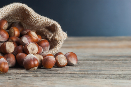 On old wooden table. heap Hazelnut background, healty food Stok Fotoğraf