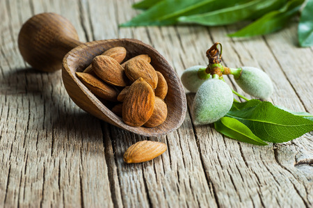 Almond nuts on wooden table Фото со стока