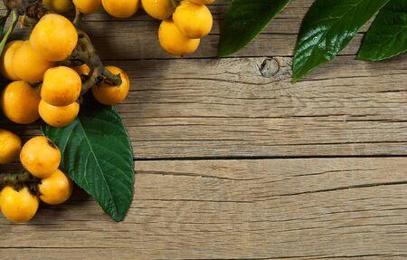 Fresh ripe loquat isolated on white background, malta plum, summer fruits concept Imagens
