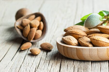 Almond nuts on wooden background