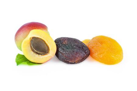 Natural dried apricot fruits isolated on white background Imagens
