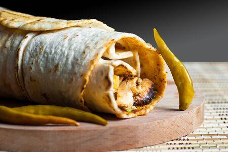 Chicken wrap doner kebab in lavash pita bread Turkish shawarma, traditional food