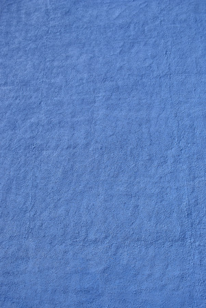 Blue granular texture on a wall