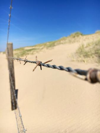 Barbed wire Noordwijk beach Stock Photo