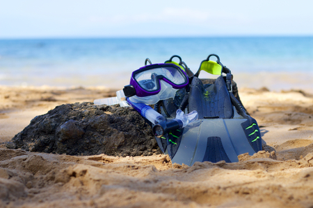 Snorkeling equipment lying on a beach Stock Photo