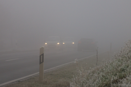 winter road: Traffic in foggy conditions