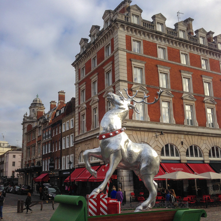 London, United Kingdom - December 4, 2015: Silver colored reindeer in front of Covent Garden Market