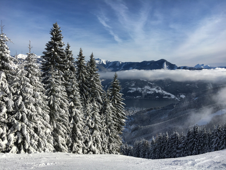 Panoramic view at ski run and Lake Zell at the Austrian ski area Schmitten in the Tyrolean alps Stock Photo