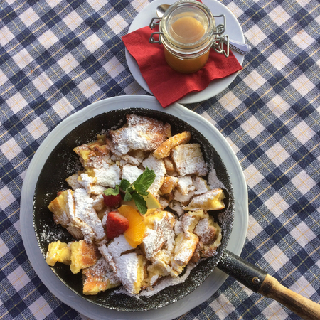 Famous Austrian dish Kaiserschmarrn served in a pan Stock Photo