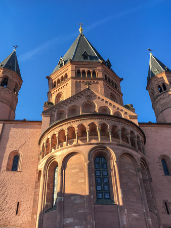 Historic Mainz Cathedral after sunrise in front of a blue sky