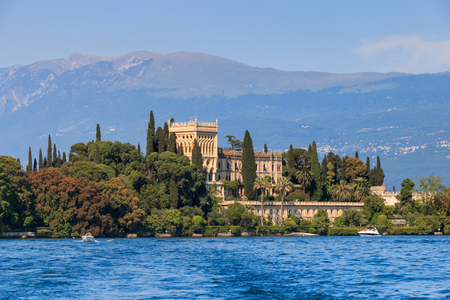 Isola del Garda is the largest island on Lake Garda dominated by the Venetian neo-Gothic building of Villa Borghese Cavazza. Stock Photo
