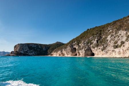 Cala Luna beach with famous caves on the Italian island of Sardinia from seaside