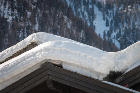 Lots of snow in the rooftop of residential houses