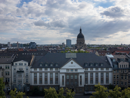 Aerial cityscape of the German city of Mainz with public library building and Christ Church (Christuskirche) in the background