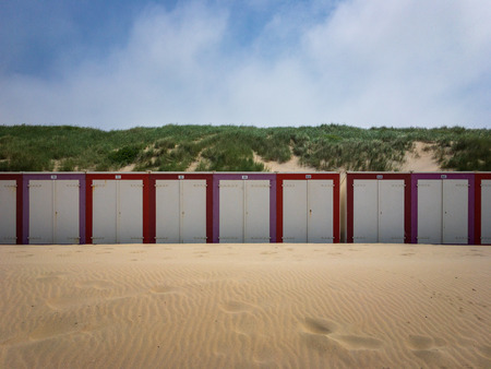 Colorful beach cabins at North Sea beach in Domburg, Zeeland, the Netherlands Imagens