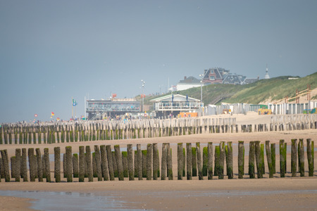 Landscape with wavebreakers at Domburg North Sea beach, Zeeland, the Netherlands on a hazy day