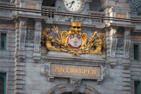 "Clock and ""Antwerpen"" lettering inside Antwerpen-Centraal (Antwerp Central) railway station in the Belgian city of Antwerp Editorial"