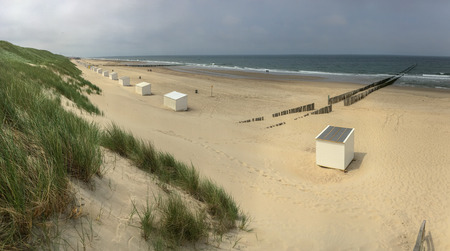 Panoramic view of North Sea beach in Domburg, Zeeland, the Netherlands with beach cabins