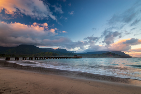 Beautiful early morning at Waioli Beach Park, Hanalei Bay on the Hawaiian island of Kauai, USA Фото со стока