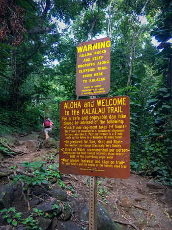 Warning sign at the starting point of Kalalau Hiking Trial giving advices for a safe and enjoyable day hike along the northern shore of the Hawaiian island of Kauai, USA