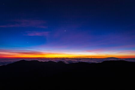 Beautiful and breathtaking sunrise at summit of Haleakala Crater in the National Park on the Hawaiian island of Maui, USA Archivio Fotografico - 125514840