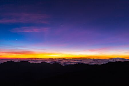 Beautiful and breathtaking sunrise at summit of Haleakala Crater in the National Park on the Hawaiian island of Maui, USA Archivio Fotografico - 125514843