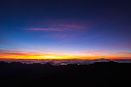 Beautiful and breathtaking sunrise at summit of Haleakala Crater in the National Park on the Hawaiian island of Maui, USA Archivio Fotografico - 125515568