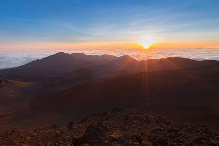 Beautiful and breathtaking sunrise at summit of Haleakala Crater in the National Park on the Hawaiian island of Maui, USA Imagens