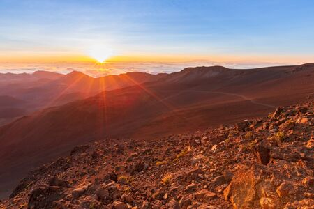 Beautiful and breathtaking sunrise at summit of Haleakala Crater in the National Park on the Hawaiian island of Maui, USA Archivio Fotografico - 125515581