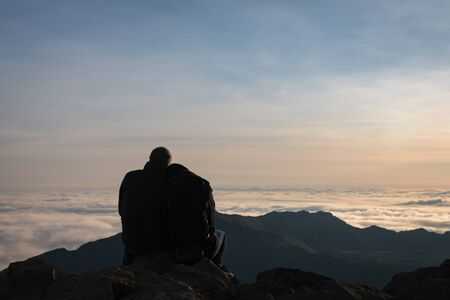 Couple at Haleakala summit on the Hawaiian island of Maui, USA watching sunrise