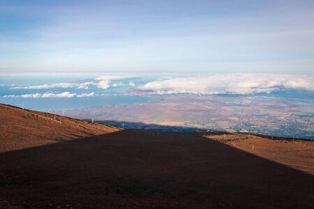 Conical shadow of Haleakala volcano at sunrise on the Hawaiian island of Maui, USA Imagens