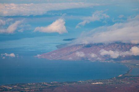 Westcoast landscape of the Hawaiian island of Maui with modern windmills seen from the top of Haleakala volcano, USA Imagens - 125515591