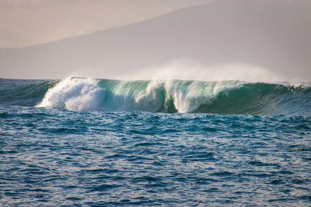 Beautiful waves crashing at Kapalua Bay beach on the Hawaiian island of Maui, USA Imagens