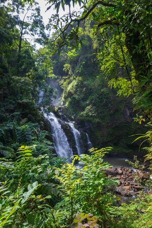 Upper Waikani Falls on the Hawaiian island of Maui at Mile 19 along the Road to Hana Imagens - 125515772