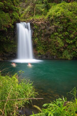 Long expo shot of Puaa Kaa Falls (Pua'a Ka'a Falls) on the Hawaiian island of Maui at Mile 22 along the Road to Hana Archivio Fotografico - 125515894